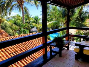 A balcony or terrace at Hotel e Pousada La Dolce Vita