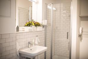 Ein Badezimmer in der Unterkunft qpartments