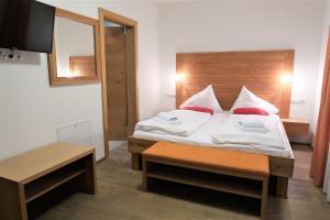 Ein Bett oder Betten in einem Zimmer der Unterkunft Mountain-Apart Simonhof
