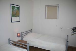 Ein Bett oder Betten in einem Zimmer der Unterkunft TopLokatie Sauerland