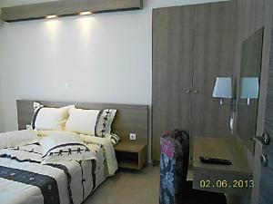 Ένα ή περισσότερα κρεβάτια σε δωμάτιο στο Karali Studios
