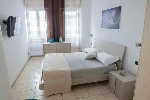 A bed or beds in a room at Casa vacanze Ķ-HOME