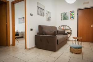 A seating area at Casa vacanze Ķ-HOME