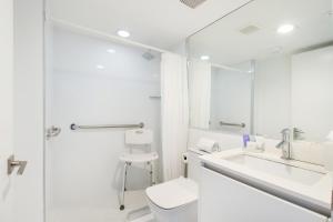 A bathroom at Beach Haus Key Biscayne Contemporary Apartments