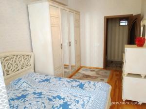 Cama ou camas em um quarto em Guest House
