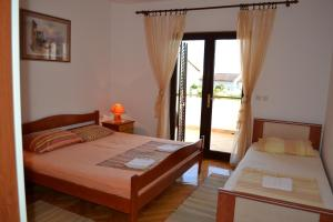 A bed or beds in a room at Apartments Karlo