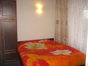 A bed or beds in a room at Upmaļi
