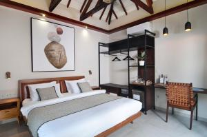 A bed or beds in a room at Ke Rensia Private Pool Villas Gili Air