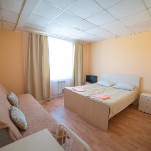 A bed or beds in a room at Mebis Baikal