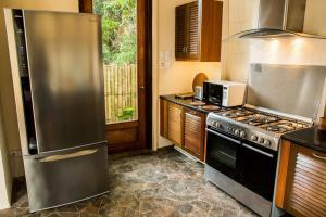 A kitchen or kitchenette at Letonezima Beach House