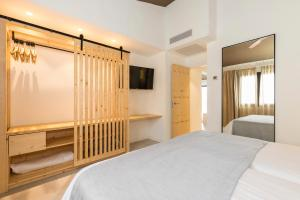 A bed or beds in a room at MarSenses Paradise Club & Spa