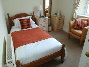 A bed or beds in a room at treverbyn house