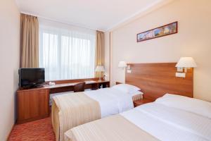Кровать или кровати в номере Отель Максима Панорама