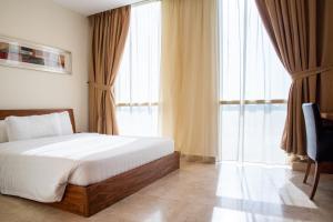 Cama ou camas em um quarto em Ottoman Signature Hotel