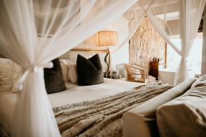A bed or beds in a room at Nambiti Hills Private Game Experience