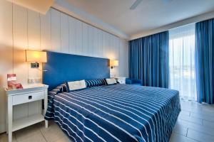 Кровать или кровати в номере db Seabank Resort + Spa All Inclusive