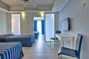 Гостиная зона в db Seabank Resort + Spa All Inclusive