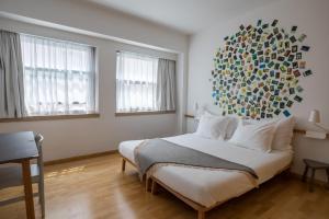 Uma cama ou camas num quarto em The Lisbonaire Apartments