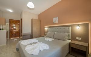 Ein Bett oder Betten in einem Zimmer der Unterkunft Pansion Mary