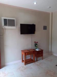 A television and/or entertainment center at D's Oceanview Beach Resort