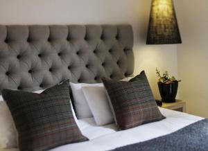 A bed or beds in a room at Perry Street Hotel
