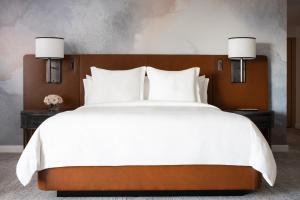 A bed or beds in a room at Four Seasons Hotel Seattle