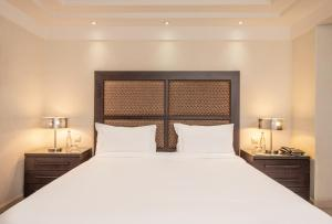 A bed or beds in a room at Odyssee Park hotel