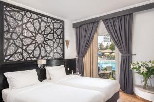 Cama o camas de una habitación en Odyssee Park hotel
