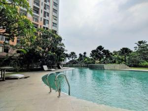 The swimming pool at or near Homey 2BR Cervino Village Apartment By Travelio