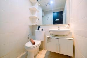 A bathroom at Homey 2BR Cervino Village Apartment By Travelio