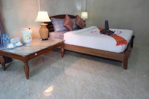 Ein Bett oder Betten in einem Zimmer der Unterkunft Coral Resort