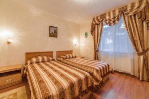 Кровать или кровати в номере Гостиничный Комплекс Театральный