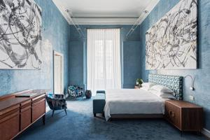A bed or beds in a room at Galleria Vik Milano