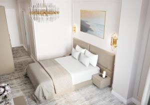 A bed or beds in a room at Lumiere Boutique Hotel