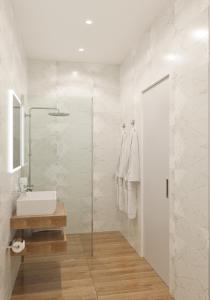 A bathroom at Lumiere Boutique Hotel