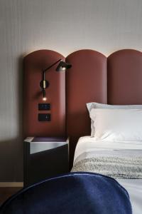 Cama o camas de una habitación en La Suite Matera Hotel & Spa