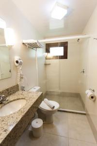 A bathroom at Tri Hotel Lago Gramado