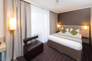 A bed or beds in a room at New Orly