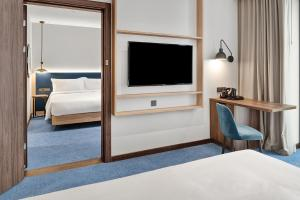 A bed or beds in a room at Hilton Garden Inn Riga Old Town