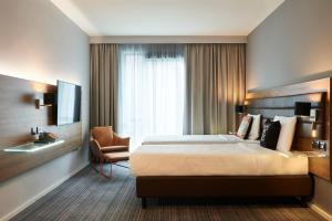 A bed or beds in a room at Moxy Dublin City