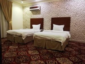 Cama ou camas em um quarto em Al Narjes AlRiyadh furnished Units