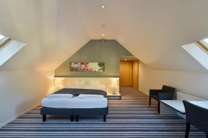 A bed or beds in a room at Hotel Vitznauerhof - Lifestyle Hideaway at Lake Lucerne