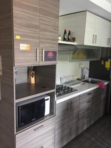 A kitchen or kitchenette at Gardenia Apartments