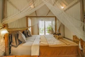 A bed or beds in a room at Villa Di Sawah Pejeng
