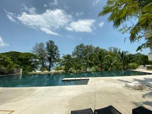 The swimming pool at or close to By The Sea @ Luxury Suites, Batu Ferringhi