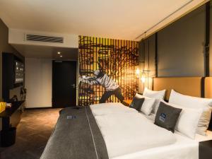 Een bed of bedden in een kamer bij the niu Cobbles