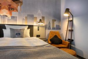 A bed or beds in a room at the niu Charly