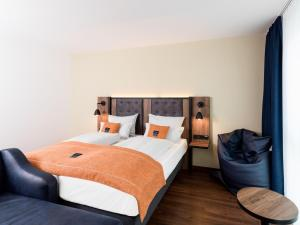 A bed or beds in a room at the niu Saddle