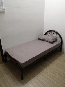 A bed or beds in a room at Homey Hostel