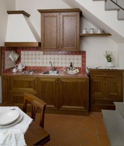 A kitchen or kitchenette at Accademia Residence